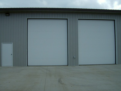 2 of 18 Clopay doors with Brush Weatherseal